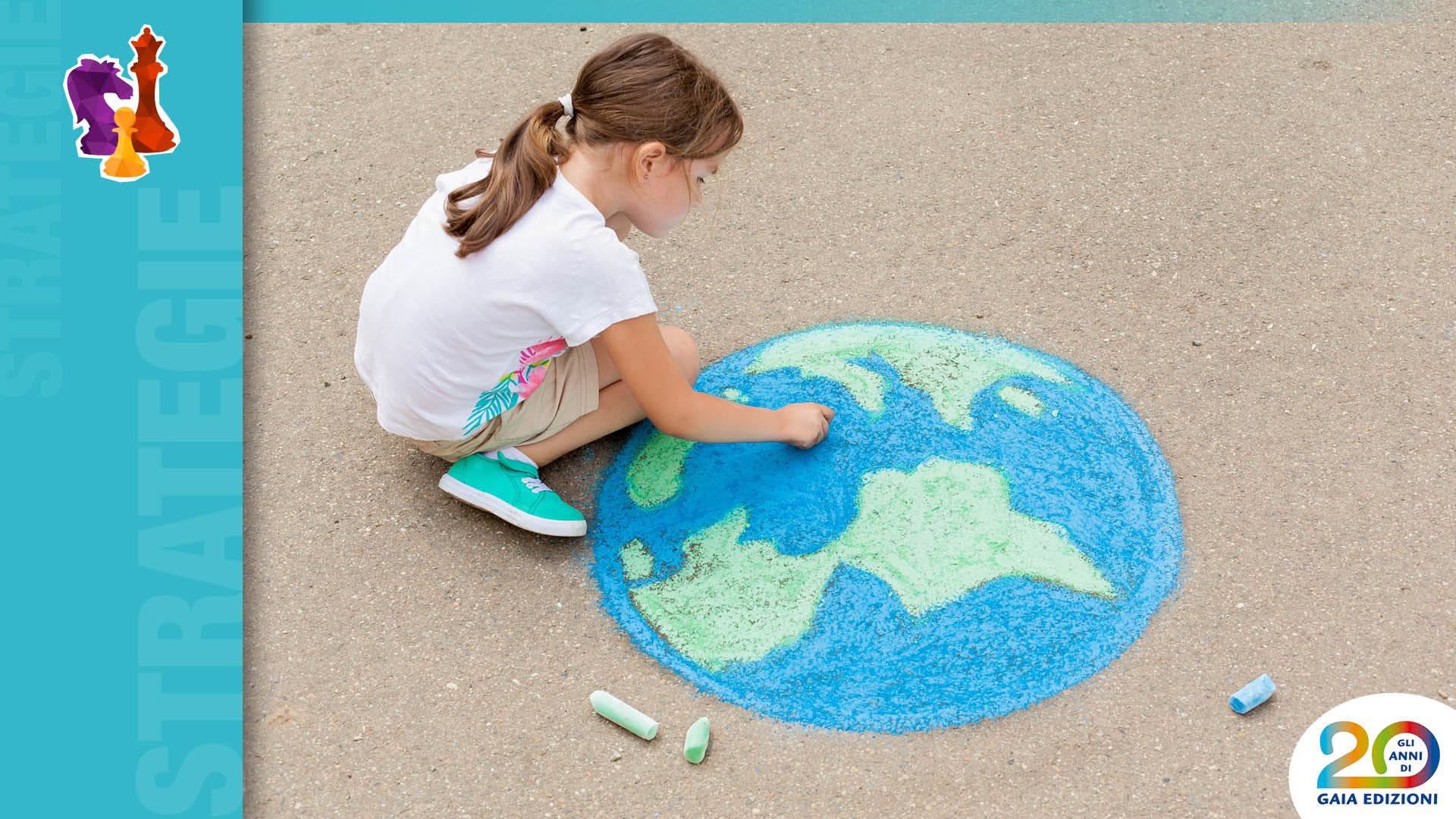 Bambina che disegna mappa della Terra